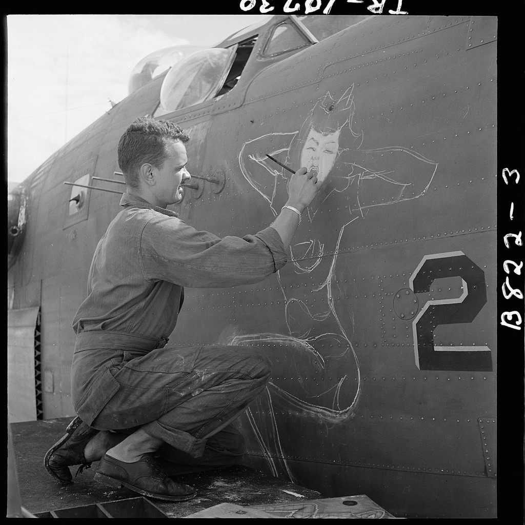 Sgt._J.S._Wilson,_USA,_painting_a_design_of_prow_of_a_bomber_based_at_Eniwetok._-_NARA_-_520724